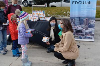 Salt Lake City Mayor Erin Mendenhall (right) and Millions of Masks for Children Co-Founder Trang Le with children at event celebrating the donation of one million masks to children across Utah. The donation was made possible by FLTR, a leading supplier of a wide range of personal protective equipment (PPE), that donated the one million masks. SmartAID and the Economic Development Corporation of Utah organized the distribution of the masks. DHL provided shipping to Utah on a pro-bono basis. Photo courtesy of Millions of Masks for Children.