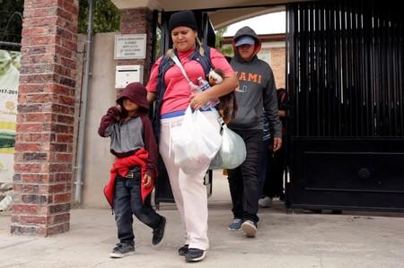 Honduran migrant Denia Carranza, 24, and her son Robert, 7, who have given up their U.S. asylum claim under the Migrant Protection Protocol (MPP), leave Casa del Migrante migrant shelter to board a bus, in Ciudad Juarez