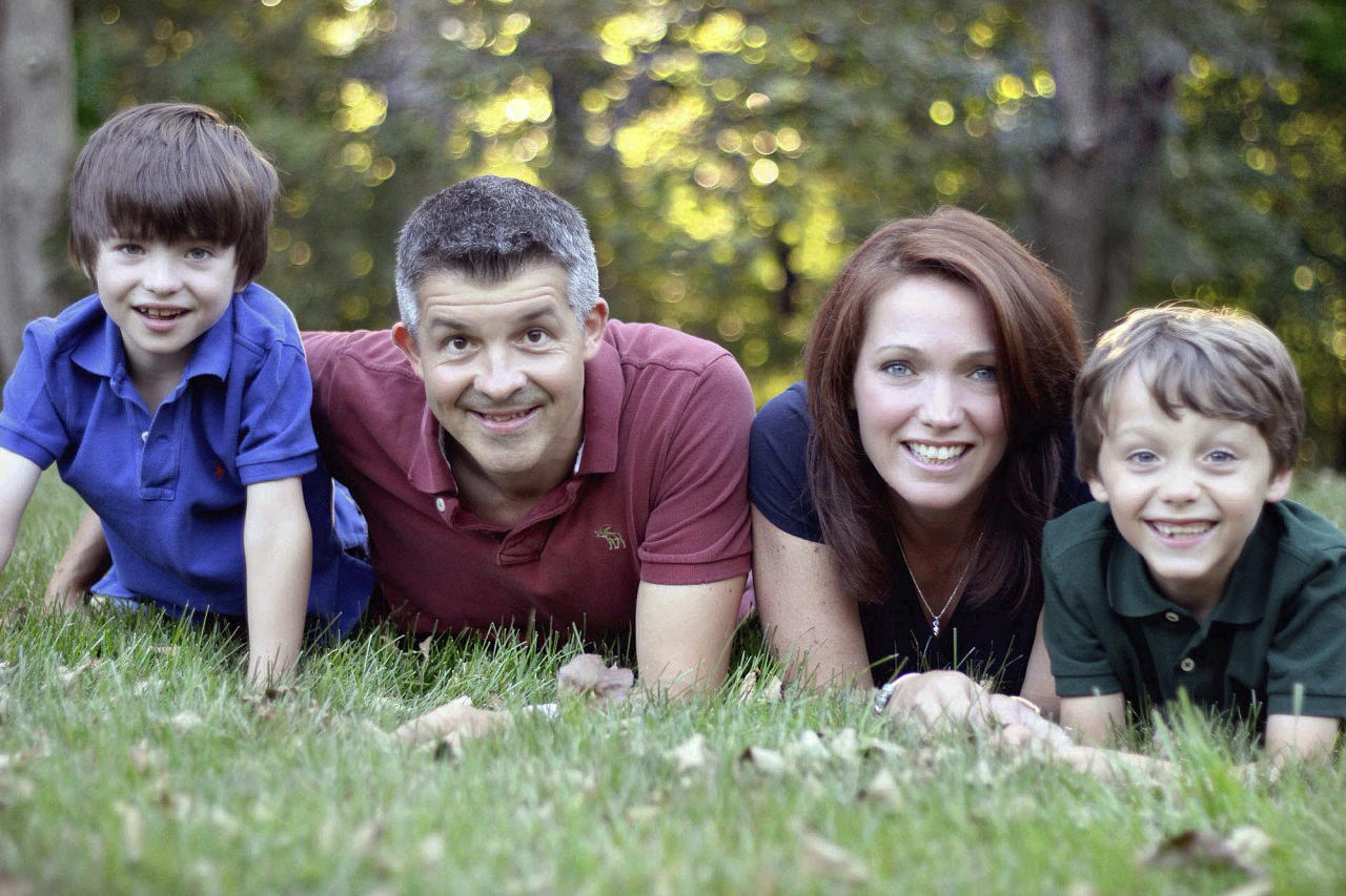 This undated family photo provided by Sandy Hook Promise shows sons Dylan, left, and Jake, right, with parents Ian and Nicole Hockley. Dylan was among those killed in the Sandy Hook Elementary School shooting on Dec. 14, 2012 in Newtown, Conn. The Hockley parents were co-founders of Sandy Hook Promise, a group that lobbied for mental health care changes and gun control legislation in the months after the shooting. (Nicole Hockley/Sandy Hook Promise via AP)