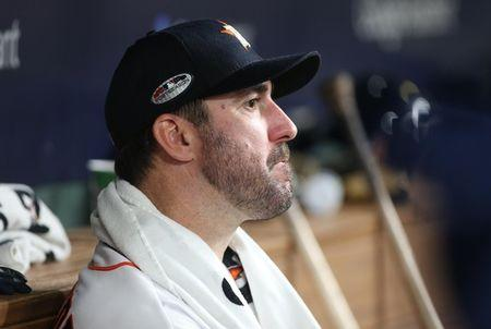 Oct 18, 2018; Houston, TX, USA; Houston Astros pitcher Justin Verlander reacts in the dugout against the Boston Red Sox in game five of the 2018 ALCS playoff baseball series at Minute Maid Park. Mandatory Credit: Troy Taormina-USA TODAY Sports