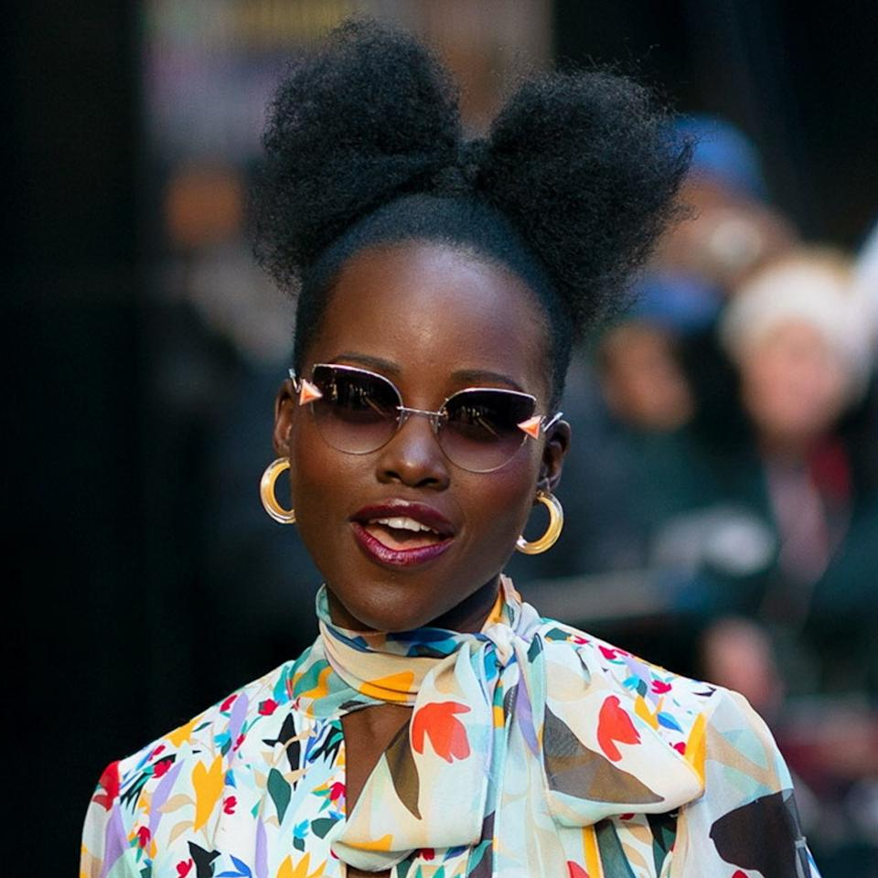 "Hairstylist <a href=""https://www.allure.com/story/vernon-francois-hair-care-line-sally-beauty?mbid=synd_yahoo_rss"">Vernon François</a> gave Lupita Nyong'o what he calls a ""<a href=""https://www.allure.com/story/lupita-nyongo-wears-a-fro-bow?mbid=synd_yahoo_rss"">'fro bow</a>"" during the promotional tour for <em>Us</em>. You can get a similar look even on much shorter hair by breaking up an Afro puff with a short braid to act as the bow's ""knot."" Shape the ""bow"" with <a href=""https://www.net-a-porter.com/us/en/product/1029073/Vernon_Francois/pure-fro-hold-and-shine-serum-50ml"" rel=""nofollow"">Vernon François Haircare Pure-Fro Hold and Shine Serum</a>."