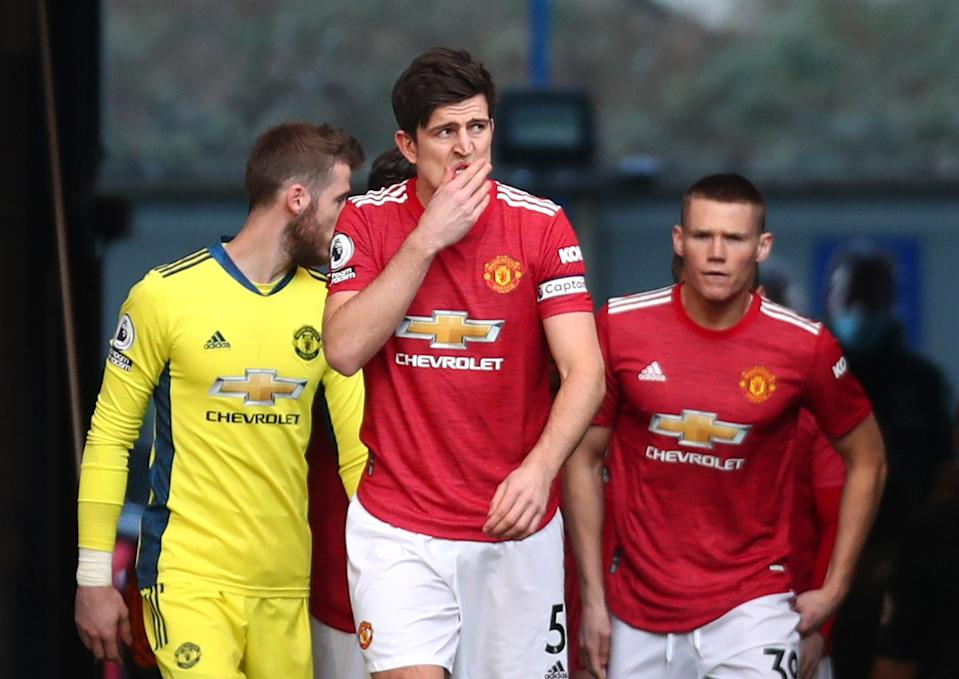 Harry Maguire emerges on to the pitch with his United teammates (Reuters)