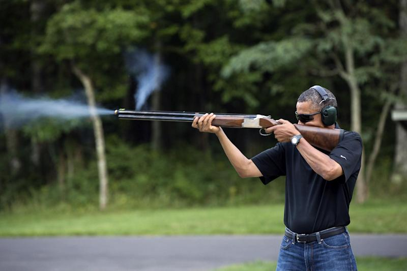 "In this photo released by the White House, President Barack Obama shoots clay targets on the range at Camp David, Md., Saturday, Aug. 4, 2012. The White House released a photo of Obama firing a gun, two days before he heads to Minnesota to discuss gun control. In a recent interview with The New Republic magazine, Obama said yes when asked if he has ever fired a gun. He said ""we do skeet shooting all the time,"" except for his daughters, at Camp David. (AP Photo/The White House, Pete Souza)"