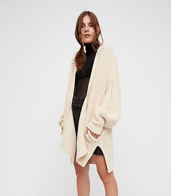"<p>A <a href=""https://www.popsugar.com/buy/cardigan-551953?p_name=cardigan&retailer=freepeople.com&pid=551953&price=108&evar1=fab%3Aus&evar9=34097656&evar98=https%3A%2F%2Fwww.popsugar.com%2Ffashion%2Fphoto-gallery%2F34097656%2Fimage%2F34098223%2FEveryday-Cardigan&list1=shopping%2Cj.crew%2Cstyle%20how%20to&prop13=mobile&pdata=1"" class=""link rapid-noclick-resp"" rel=""nofollow noopener"" target=""_blank"" data-ylk=""slk:cardigan"">cardigan</a> ($108) in a neutral color is going to go with just about everything in your closet. It's a light layering tool that's polished, classic, and perfect for everything from the office to dinner out with friends. </p>"