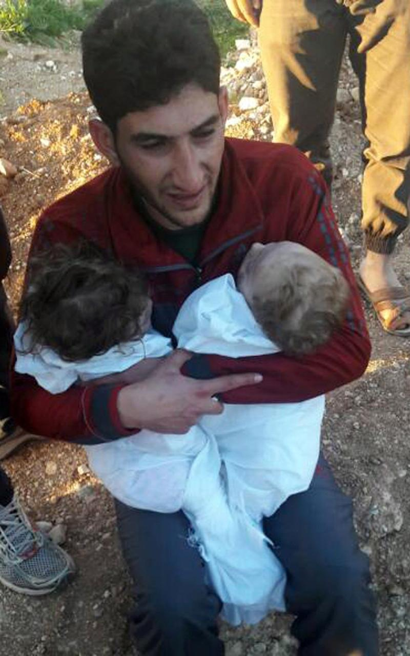 In this picture taken on Tuesday April 4, 2017, Abdul-Hamid Alyousef, 29, cries as he holds his twin babies who were killed during a suspected chemical weapons attack, in Khan Sheikhoun town, in the northern province of Idlib, Syria. Alyousef also lost his wife, two brothers, nephews and many other family members in the attack that claimed scores of his relatives. - Credit: Alaa Alyousef/Via AP