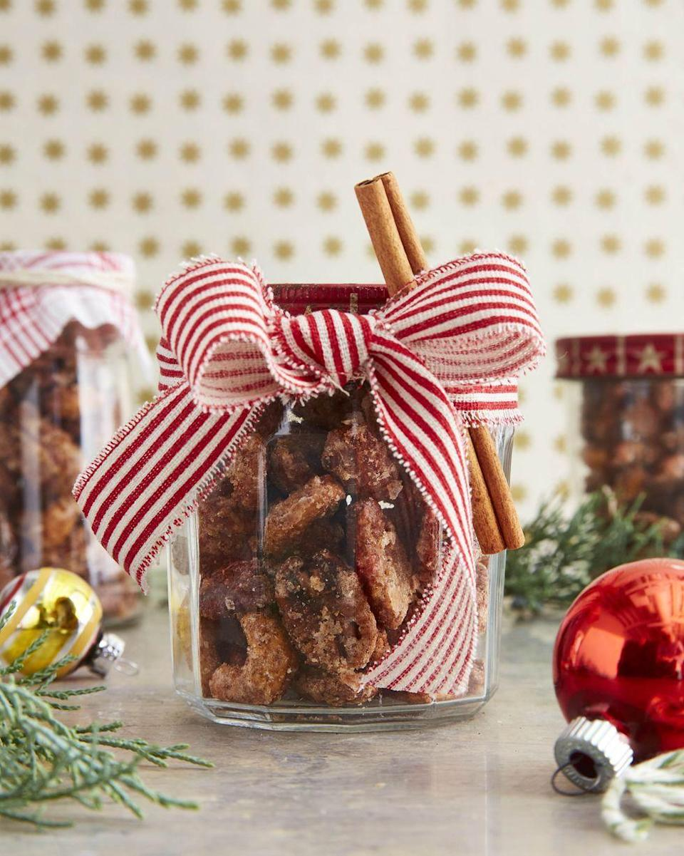 """<p>It wouldn't be Christmas without specially-flavored nuts, and this candied, crunchy bunch with a hint of fire is even better because you whipped it up yourself.</p><p><strong><a href=""""https://www.countryliving.com/food-drinks/a34332174/sweet-and-spicy-coated-nuts-recipe/"""" rel=""""nofollow noopener"""" target=""""_blank"""" data-ylk=""""slk:Get the recipe"""" class=""""link rapid-noclick-resp"""">Get the recipe</a>.</strong></p><p><a class=""""link rapid-noclick-resp"""" href=""""https://www.amazon.com/LaRibbons-White-Striped-Grosgrain-Ribbon/dp/B073W76M31/ref=sr_1_3?tag=syn-yahoo-20&ascsubtag=%5Bartid%7C10050.g.645%5Bsrc%7Cyahoo-us"""" rel=""""nofollow noopener"""" target=""""_blank"""" data-ylk=""""slk:SHOP RED AND WHITE RIBBON"""">SHOP RED AND WHITE RIBBON</a></p>"""