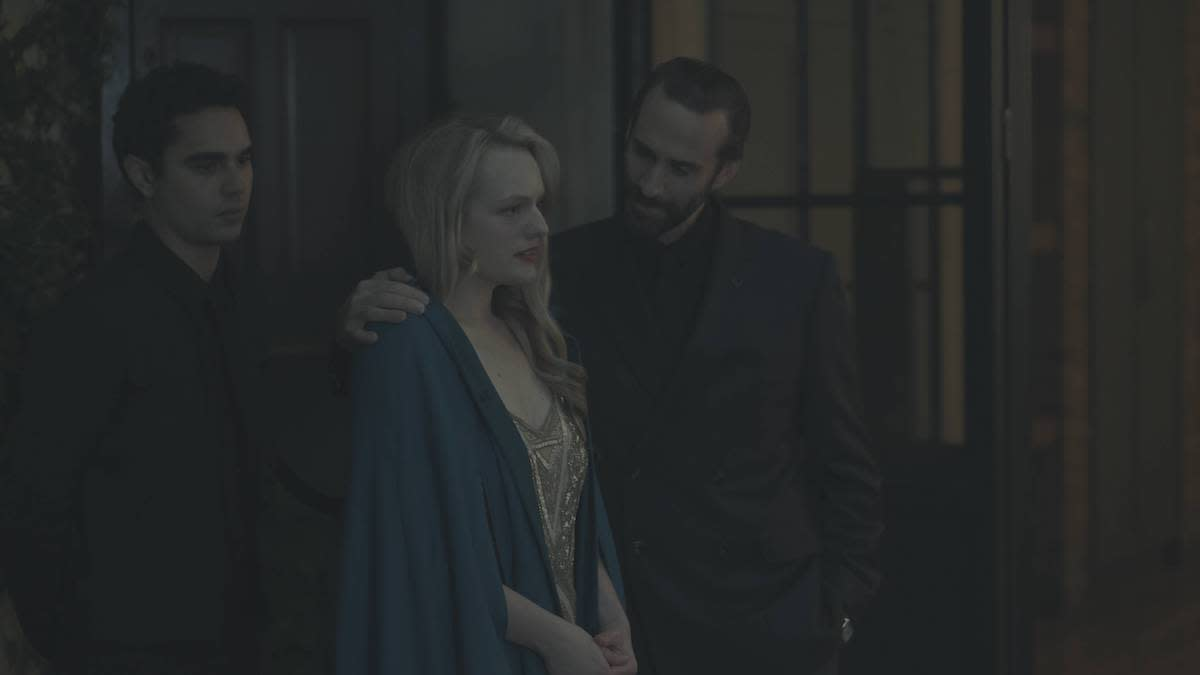 <p>From left, Max Minghella as Nick, Elisabeth Moss as Offred, and Joseph Fiennes as Commander Waterford in Hulu's The Handmaid's Tale. (Credit: George Kraychyk/Hulu) </p>