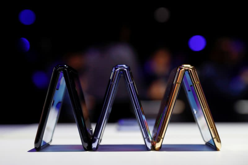 A trio of Samsung Galaxy Z Flip foldable smartphones is seen during Samsung Galaxy Unpacked 2020 in San Francisco