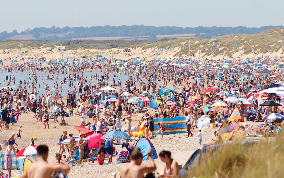 A packed Camber Sands, in East Sussex, as UK holidaymakers flocked to the south coast on one of the hottest days of the year - PAL Media/Alamy Live News/PAL Media/Alamy Live News