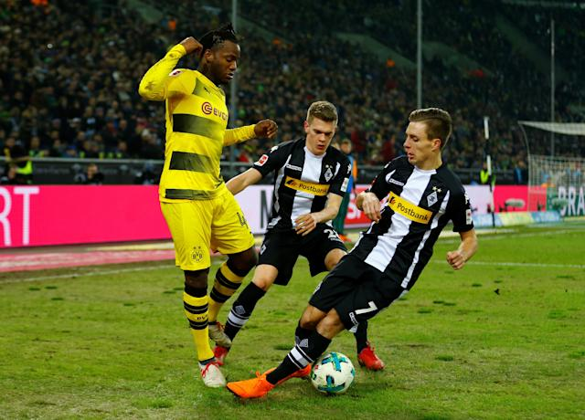 Soccer Football - Bundesliga - Borussia Moenchengladbach vs Borussia Dortmund - Borussia-Park, Moenchengladbach, Germany - February 18, 2018 Borussia Dortmund's Michy Batshuayi in action with Borussia Monchengladbach's Patrick Herrmann and Matthias Ginter REUTERS/Thilo Schmuelgen DFL RULES TO LIMIT THE ONLINE USAGE DURING MATCH TIME TO 15 PICTURES PER GAME. IMAGE SEQUENCES TO SIMULATE VIDEO IS NOT ALLOWED AT ANY TIME. FOR FURTHER QUERIES PLEASE CONTACT DFL DIRECTLY AT + 49 69 650050