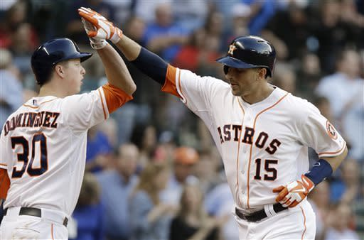 Houston Astros' Matt Dominguez (30) welcomes Jason Castro (15), who hit a three-run home run against the Oakland Athletics in the fourth inning of a baseball game Saturday, April 6, 2013, in Houston. (AP Photo/Pat Sullivan)