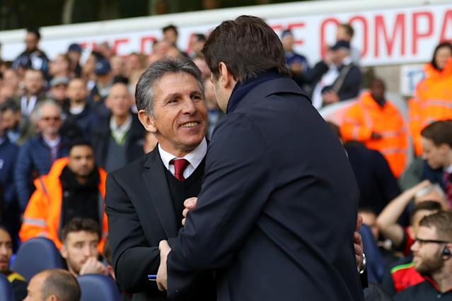 <p>Pochettino and Puel share a joke </p>