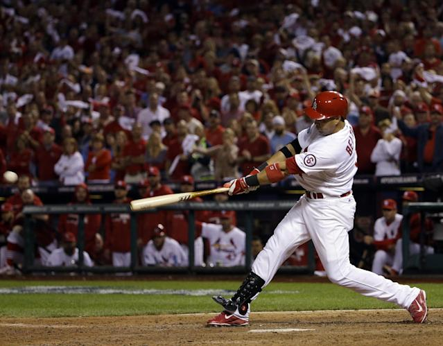 St. Louis Cardinals' Carlos Beltran hits his game-winning hit during the 13th inning of Game 1 of the National League baseball championship series against the Los Angeles Dodgers Saturday, Oct. 12, 2013, in St. Louis. (AP Photo/David J. Phillip)