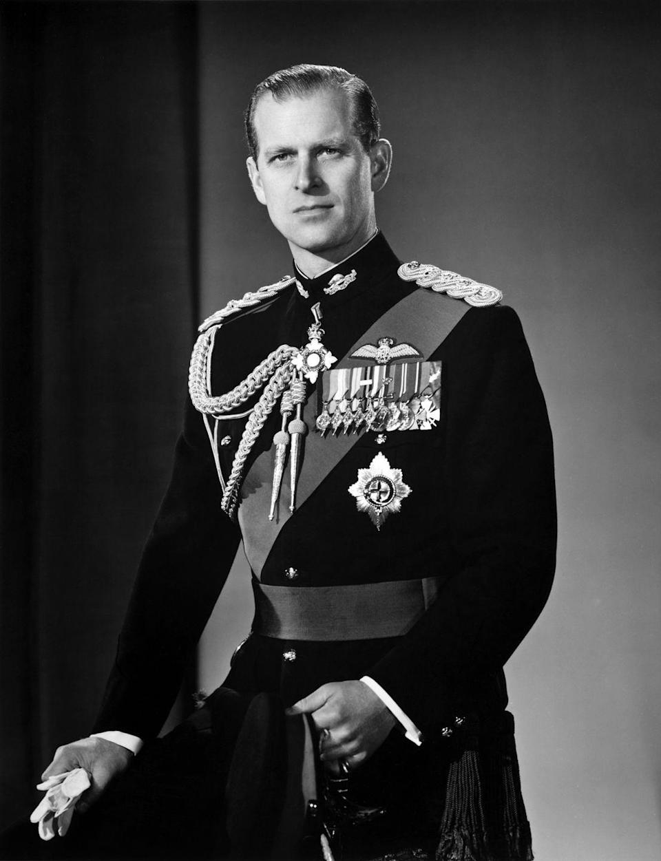<p>Prince Philip poses for a portrait at home in Buckingham Palace in December 1958.</p>