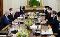 US President Joe Biden and Japan's Prime Minister Yoshihide Suga meet in the State Dining Room of the White House with top aides