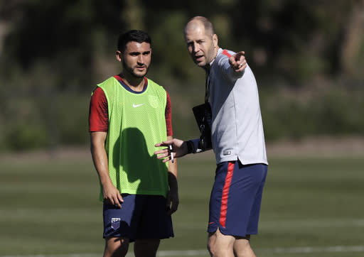 United States men's coach Gregg Berhalter (right) instructs Cristian Roldan during training camp. (AP)