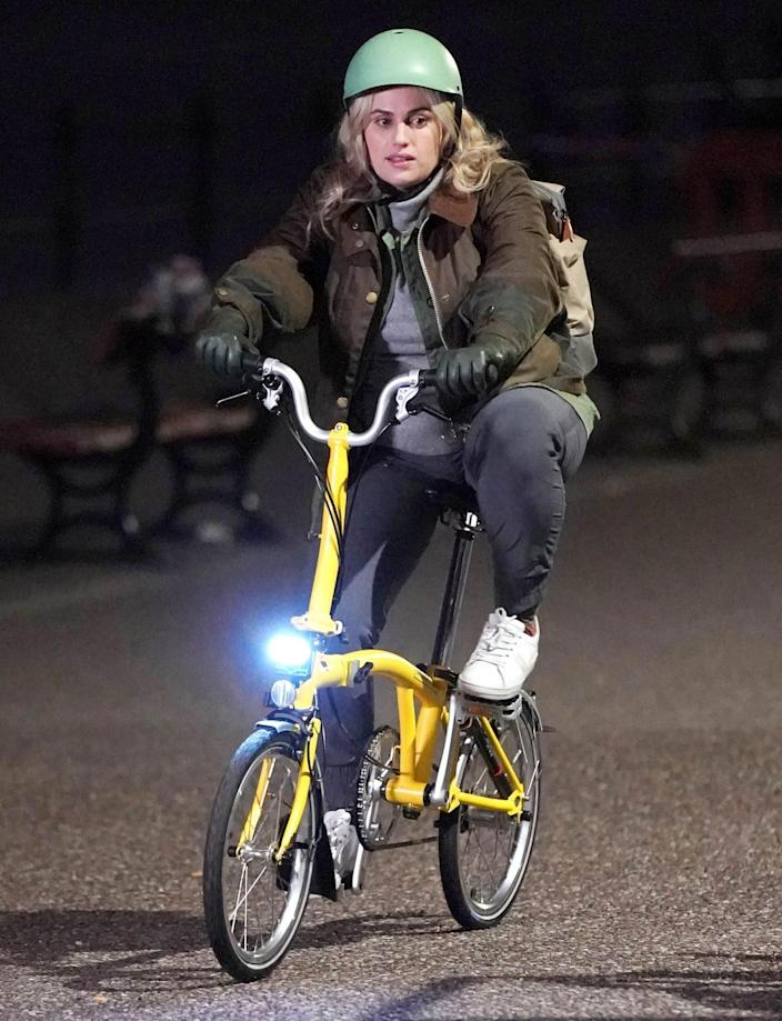 """<p>Rebel Wilson is seen back on a bike while filming her new movie in Merseyside, England, one month after sharing she'd <a href=""""https://people.com/movies/rebel-wilson-injured-bike-ride-london/"""" rel=""""nofollow noopener"""" target=""""_blank"""" data-ylk=""""slk:been injured in a bike accident"""" class=""""link rapid-noclick-resp"""">been injured in a bike accident</a> in London. </p>"""