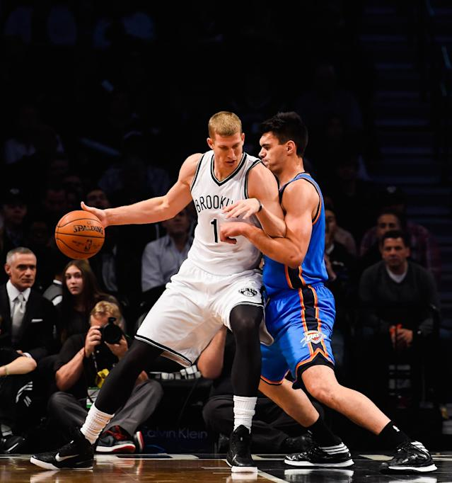Mason Plumlee of the Brooklyn Nets attempts to drive past Steven Adams of Oklahoma City Thunder in the first half at the Barclays Center on November 3, 2014 in the Brooklyn borough of New York City (AFP Photo/Alex Goodlett)
