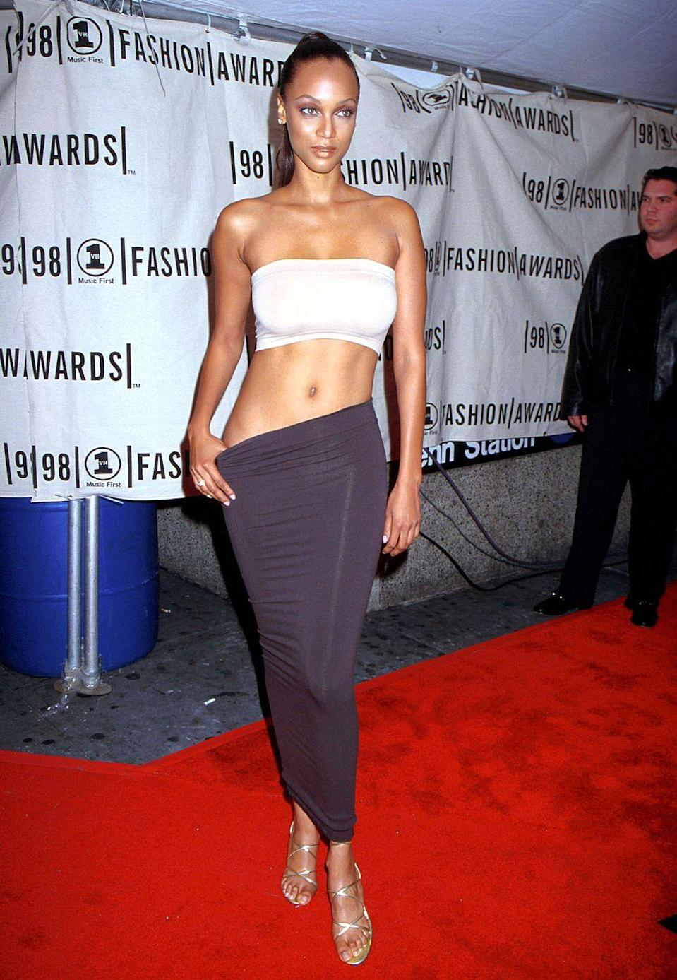 <p>Like her cropped tube top and tube skirt, Tyra Banks's metallic, shiny shoes were also a '90s fashion staple.</p>