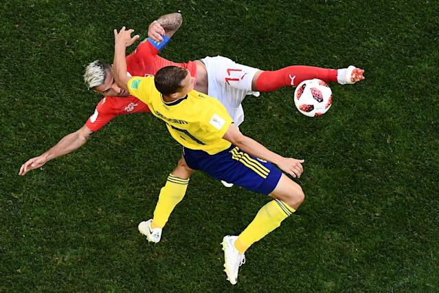 <p>Sweden's midfielder Viktor Claesson vies with Switzerland's midfielder Valon Behrami (top) during the Russia 2018 World Cup round of 16 football match between Sweden and Switzerland at the Saint Petersburg Stadium in Saint Petersburg on July 3, 2018. (Photo by Jewel SAMAD / AFP) </p>