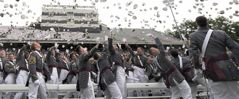 U.S. Military Academy graduates toss their hats during commencement ceremonies at West Point, N.Y., May 23, 2009.