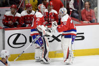 Washington Capitals goaltender Ilya Samsonov (30), of Russia, skates to the bench as goaltender Braden Holtby (70) comes in to replace him during the second period of an NHL hockey game against the New York Islanders, Monday, Feb. 10, 2020, in Washington. (AP Photo/Nick Wass)