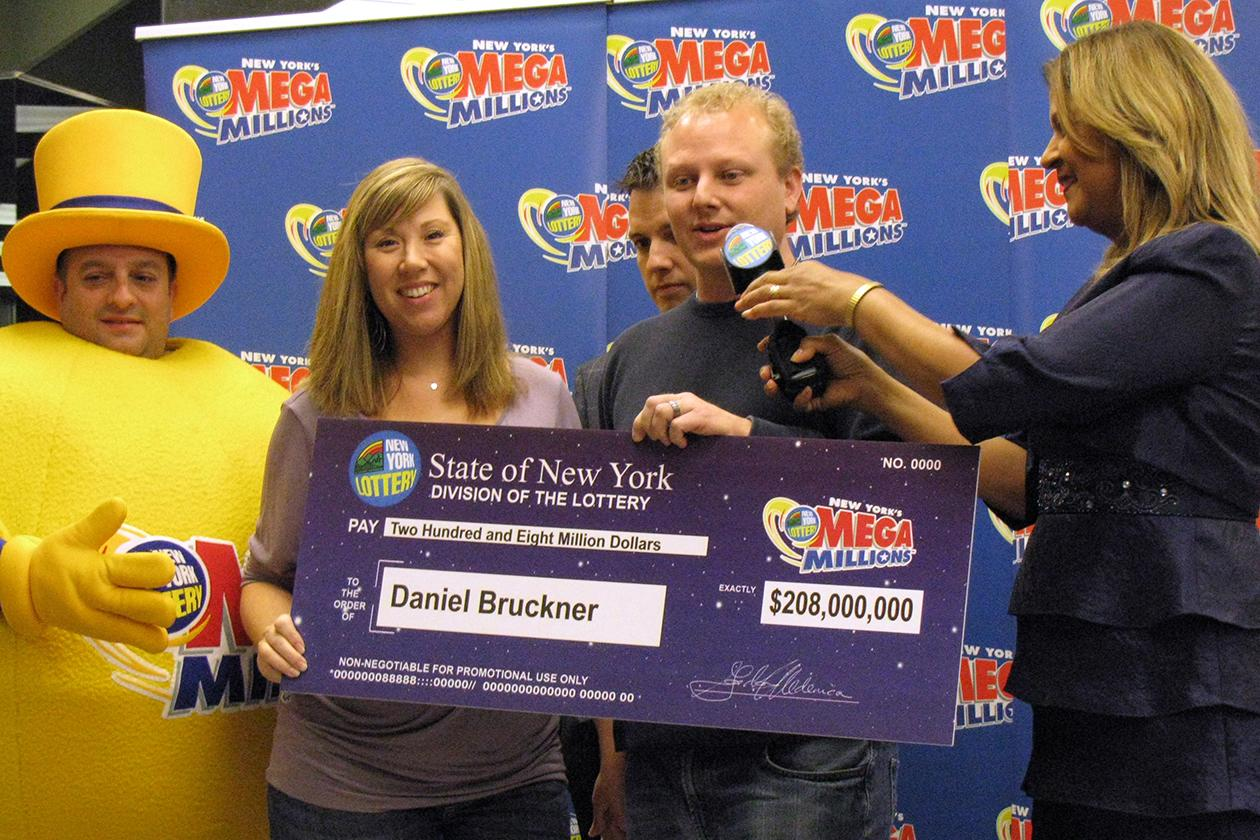 <b>$208 million</b><br><br>Daniel Bruckner of San Jose, Calif., 35, and his wife Christine, hold an oversized mock-up of a check as the Bruckners claim $208 million at the King Kullen supermarket where Daniel Bruckner purchased his Mega Millions winning ticket, in Middle Island, N.Y. At right is Yolanda Vega, the official voice of the New York Lottery's twice-weekly Lotto drawings.