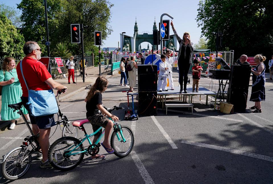 Local residents celebrate at the southern foot of Hammersmith Bridge in London as it reopens to pedestrians and cyclists (Jonathan Brady/PA) (PA Wire)