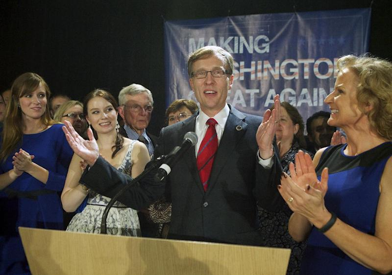 Rob McKenna, Republican candidate for Washington Governor, talks to supporters, while daughters, Madelin, Katie and wife Marilyn applaud, Tuesday, Nov. 6, 2012, in Bellevue, Wash. (AP Photo/Stephen Brashear)
