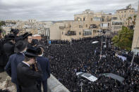 Thousands of ultra-Orthodox Jews participate in funeral for prominent rabbi Meshulam Soloveitchik, in Jerusalem, Sunday, Jan. 31, 2021. The mass ceremony took place despite the country's health regulations banning large public gatherings, during a nationwide lockdown to curb the spread of the virus. (AP Photo/Ariel Schalit)