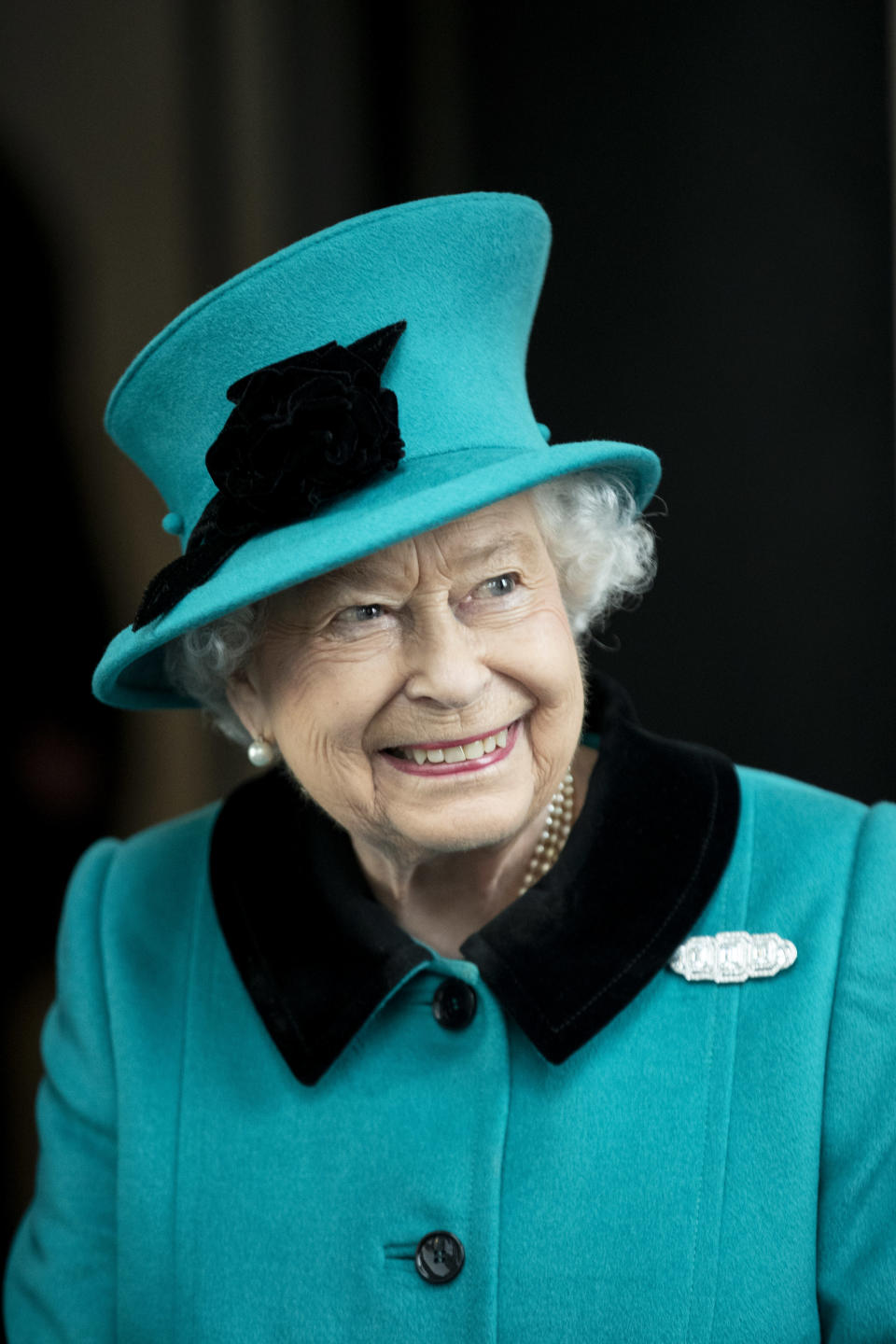 <p>The Queen looks lovely in a teal coat and hat as she visits the new Schroders plc Headquarters in November (Getty) </p>