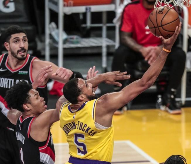 Los Angeles, CA, Monday, December 28, 2020 - Los Angeles Lakers guard Talen Horton-Tucker (5) slices past Portland Trail Blazers guard Anfernee Simons (1) for a first half layup at Staples Center. (Robert Gauthier/ Los Angeles Times)