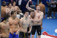 Britain celebrates after winning the mens' 4x200-meter freestyle relay at the 2020 Summer Olympics, Wednesday, July 28, 2021, in Tokyo, Japan. (AP Photo/Charlie Riedel)