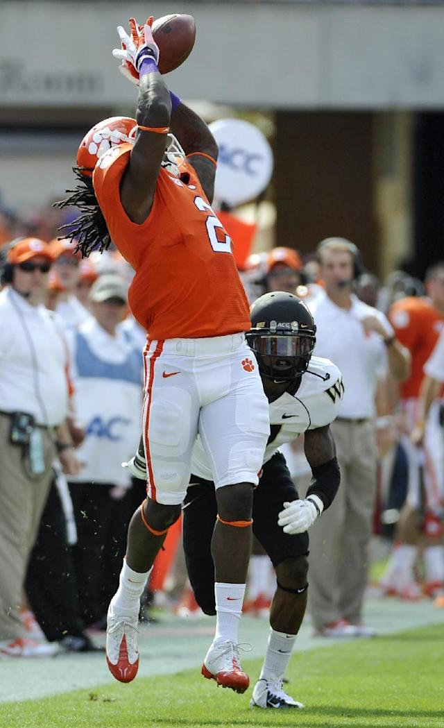 Clemson wide receiver Sammy Watkins (2) makes a catch as Wake Forest cornerback Merrill Noel (7) defends during the first half of an NCAA college football game, Saturday, Sept. 28, 2013, in Clemson, S.C. Watkins scored a touchdown on the play. (AP Photo/Rainier Ehrhardt)