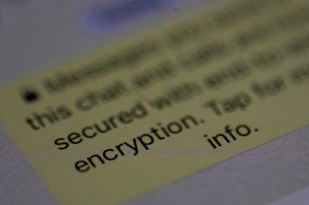 FILE PHOTO: An encryption message is seen on the  WhatsApp application on an iPhone in Manchester , Britain March 27, 2017. REUTERS/Phil Noble