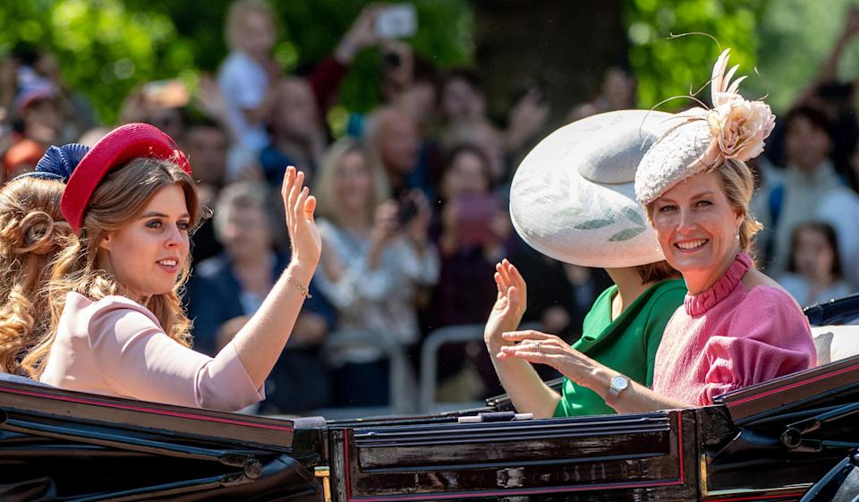 <p>Princess Beatrice wears a dusty pink dress and crimson hat, while sat opposite, Sophie Countess of Wessex went for a bubblegum pink, high-neck dress and a pale, decorative hat.<br><em>[Photo: Getty]</em> </p>