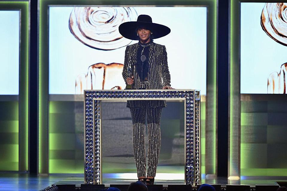 <p>Queen Bey can wear whatever she wants, always – but especially if it's a sparkly pinstriped Givenchy suit and larger-than-life hat. <i>(Photo by Theo Wargo/Getty Images)</i><br></p>