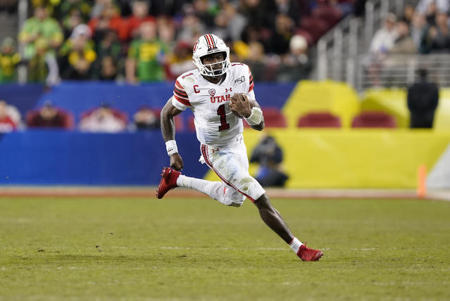 Utah quarterback Tyler Huntley (1) scrabbles for a first down against Oregon during the second half of the Pac-12 Conference championship NCAA college football game in Santa Clara, Calif., Friday, Dec. 6, 2018. (AP Photo/Tony Avelar)