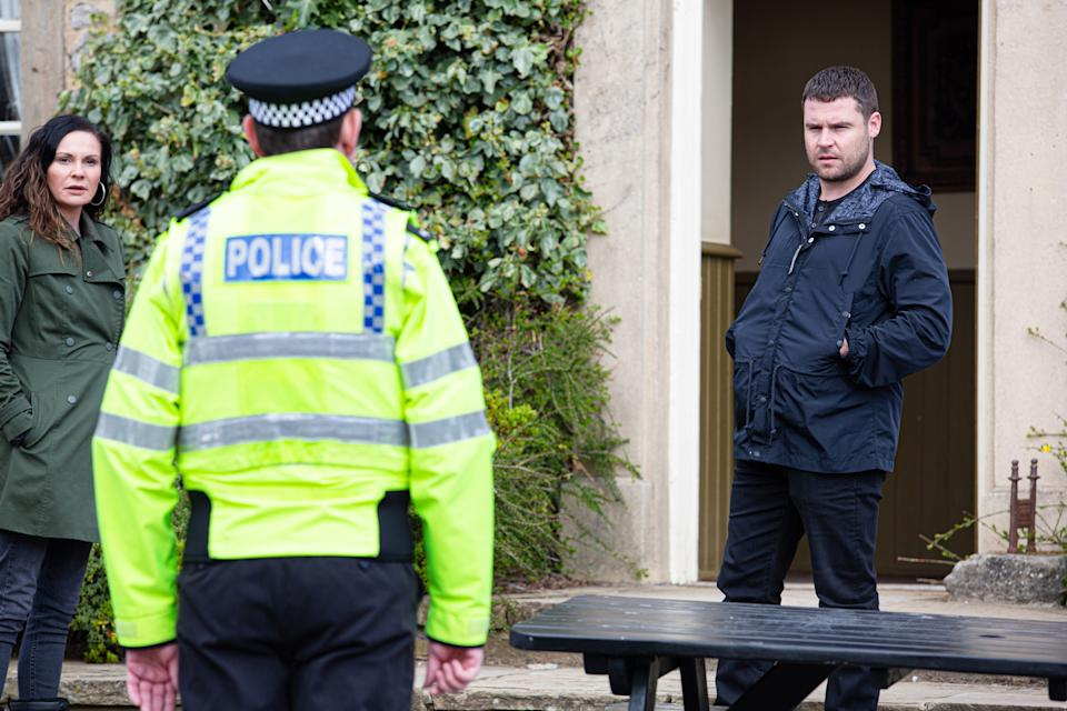 FROM ITV  STRICT EMBARGO  Print media - No Use Before Tuesday 11th May 2021 Online Media - No Use Before 0700hrs Tuesday 11th May  2021  Emmerdale - Ep 9050  Tuesday 18th May 2021  The police inform Pollard [CHRIS CHITTELL] the charges against him have been dropped and take Aaron Dingle [DANNY MILLER]  in for questioning.   Picture contact David.crook@itv.com   Photographer - Mark Bruce  This photograph is (C) ITV Plc and can only be reproduced for editorial purposes directly in connection with the programme or event mentioned above, or ITV plc. Once made available by ITV plc Picture Desk, this photograph can be reproduced once only up until the transmission [TX] date and no reproduction fee will be charged. Any subsequent usage may incur a fee. This photograph must not be manipulated [excluding basic cropping] in a manner which alters the visual appearance of the person photographed deemed detrimental or inappropriate by ITV plc Picture Desk. This photograph must not be syndicated to any other company, publication or website, or permanently archived, without the express written permission of ITV Picture Desk. Full Terms and conditions are available on  www.itv.com/presscentre/itvpictures/terms