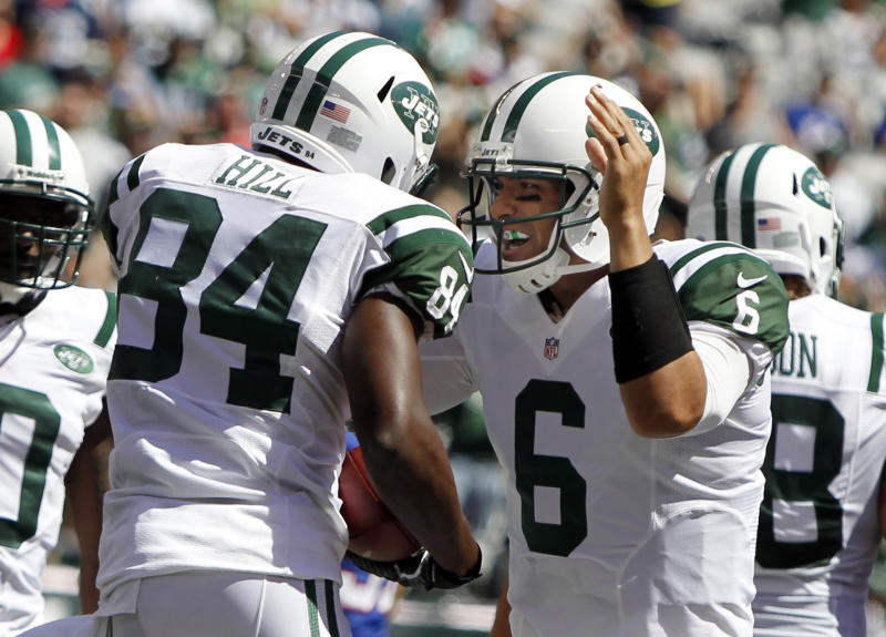 New York Jets quarterback Mark Sanchez celebrates with wide receiver Stephen Hill after Hill scored a touchdown during the first half of an NFL football game against the Buffalo Bills at MetLife Stadium, Sunday, Sept. 9, 2012, in East Rutherford, N.J. (AP Photo/Mel Evans)
