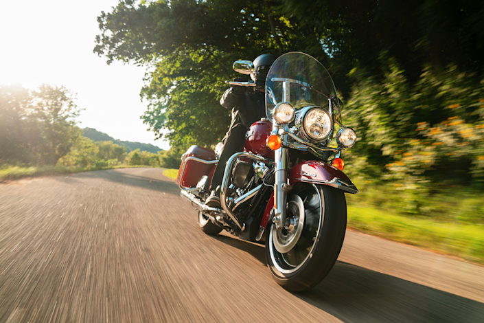 A motorcycle rider driving the Harley-Davidson Road King. This big, old-school bike is one of the models helping save the company.