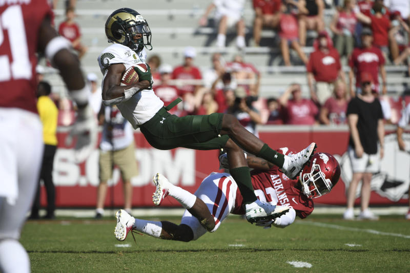 Colorado State receiver Warren Jackson makes a catch at the one-yard line in front of Arkansas defender Kamren Curl in the first half of an NCAA college football game, Saturday, Sept. 14, 2019 in Fayetteville, Ark. (AP Photo/Michael Woods)