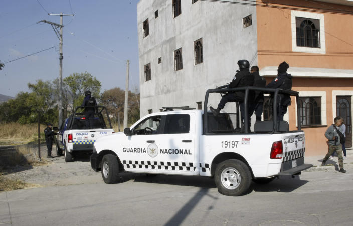 National Guard police enter the site where mass graves were found in Salvatierra, Guanajuato state, Mexico, Thursday, Oct. 29, 2020. A Mexican search group said Wednesday it has found 59 bodies in a series of clandestine burial pits in the north-central state of Guanajuato, and that more could still be excavated. (AP Photo/Mario Armas)