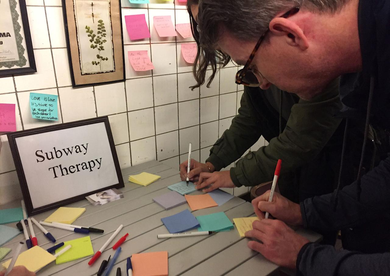 <p>Subway riders leave Post-it notes on the walls of a subway tunnel on Nov. 10, 2016, in New York City. New York commuters are venting their anger and frustration over Republican Donald Trump's shocking victory by indulging in collective therapy — writing messages on Post-it notes and sticking them on a subway tunnel wall. (Catherine Triomphe/AFP/Getty Images) </p>