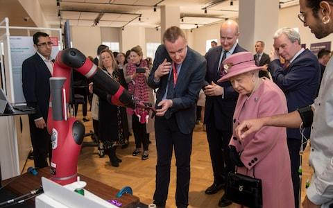 The Queen is shown a robot arm - Credit: Paul Grover