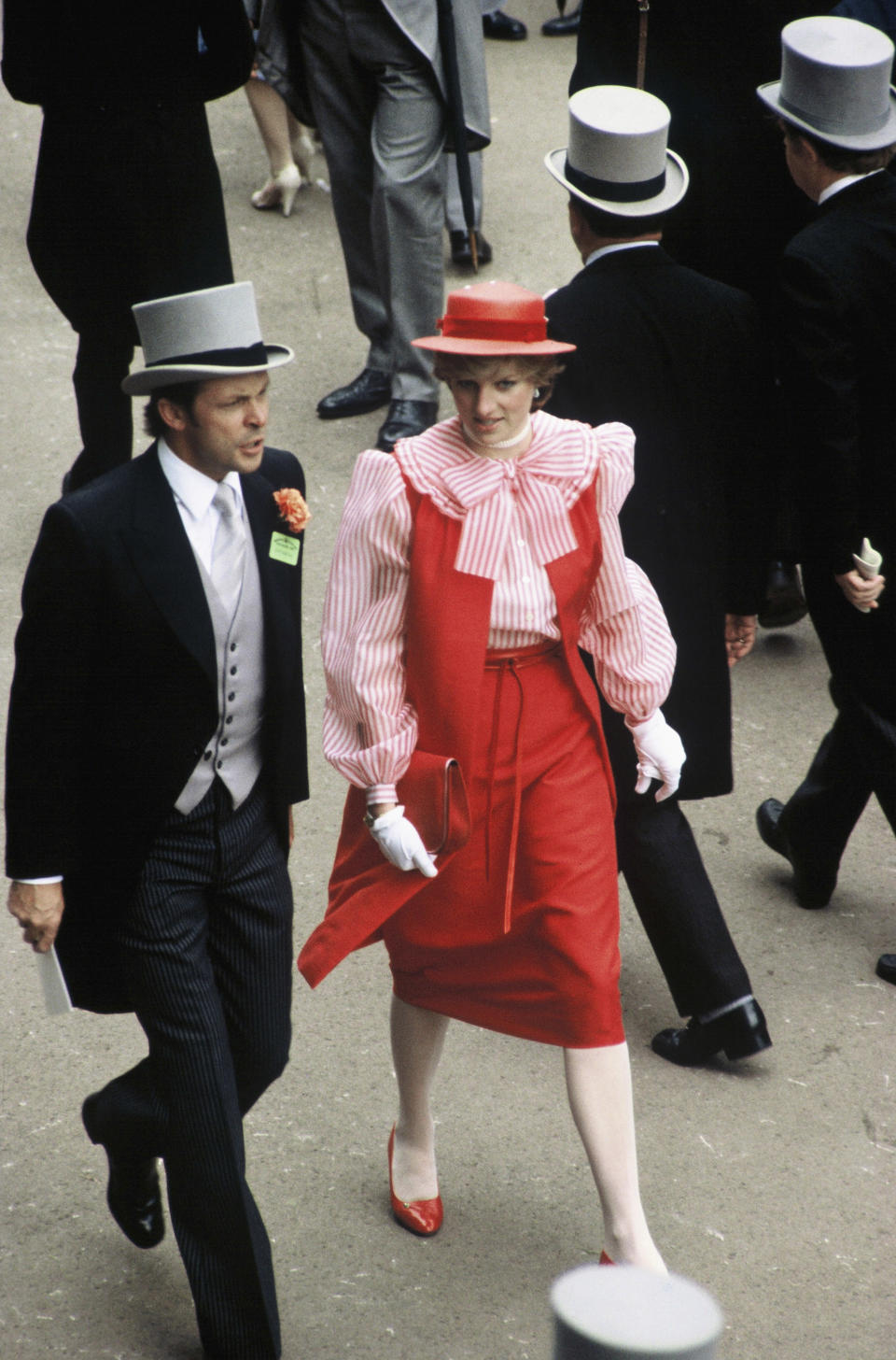 <p>At her first ever Ascot in 1981, Princess Diana wore a red dress with a pierrot-style shirt by Bellville Sassoon.<em> [Photo: Getty]</em> </p>