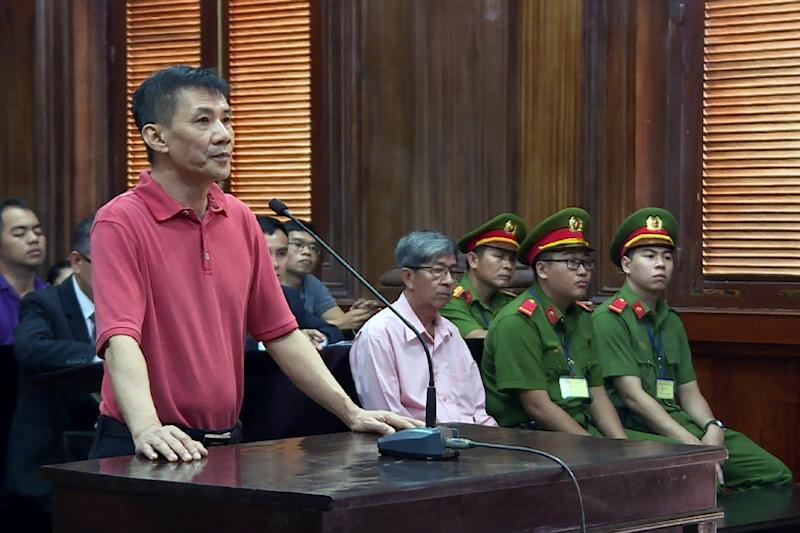 US citizen Michael Nguyen (L) was convicted during a half-day trial in a Ho Chi Minh City court