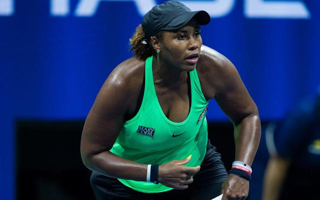 Taylor Townsend serves at the US Open - GETTY IMAGES