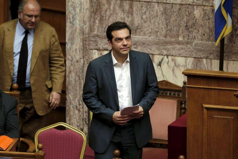 Greek PM Tsipras arrives for a parliamentary session in Athens
