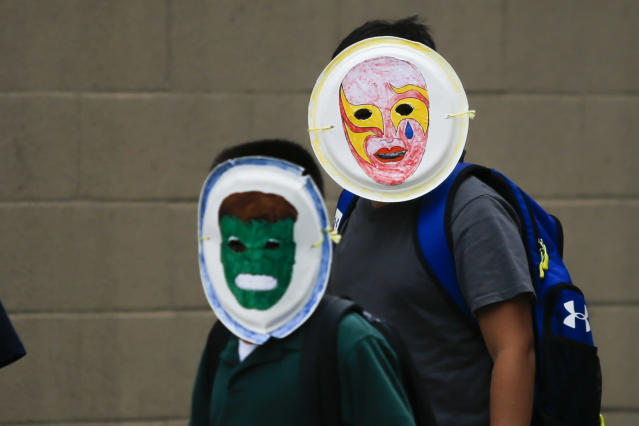 Children wearing masks exit the Cayuga Centers branch on June 22, 2018 in Harlem, N.Y. More than 239 migrant children who were separated from their parents and relatives at the U.S.-Mexico border are under Cayuga Centers care in New York. (Photo: Eduardo MunozAlvarez/VIEWpress/Corbis via Getty Images)